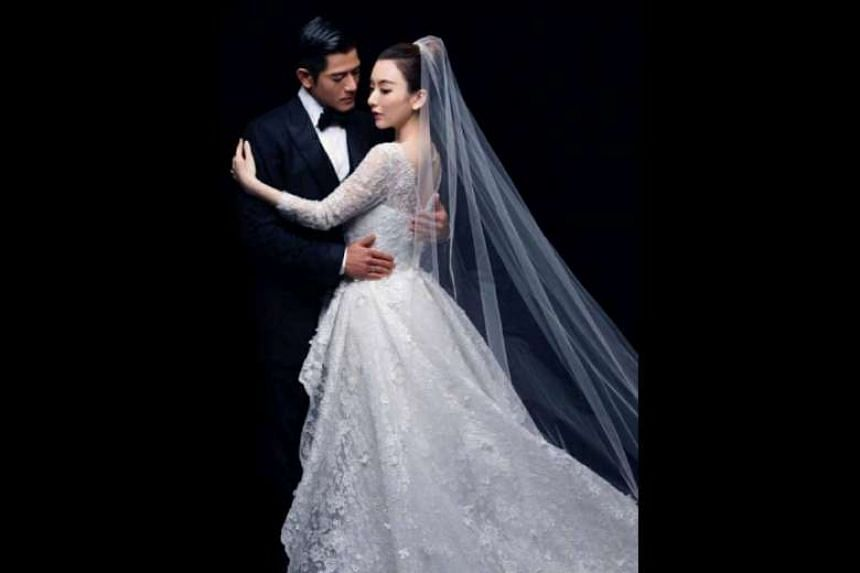 Aaron Kwok is in a Tom Ford suit and Moka Fang is in a Georges Hobeika wedding dress. This wedding photo was taken by Wing Shya.