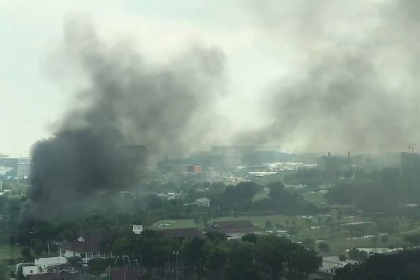 The fire at the vehicle scrapyard along Penjuru Road sent thick black smoke into the air.