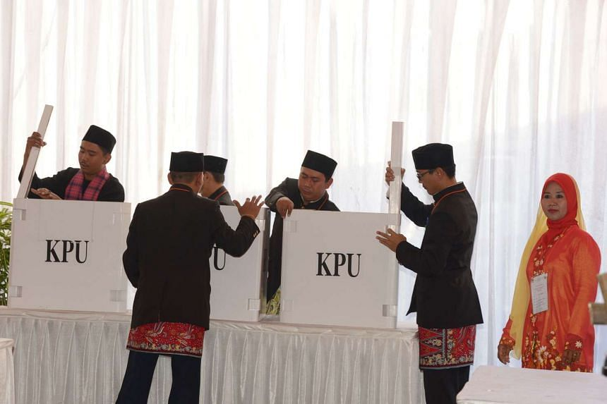 Indonesian members of the Jakarta election committee preparing a poll where Anis Baswedan, one of the candidates, will cast his ballot papers in Jakarta on April 19, 2017.