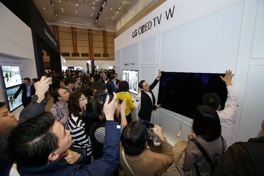 The ultra-thin Oled TV W7 weighs around 8kg and can be mounted directly to the wall using magnetic brackets.