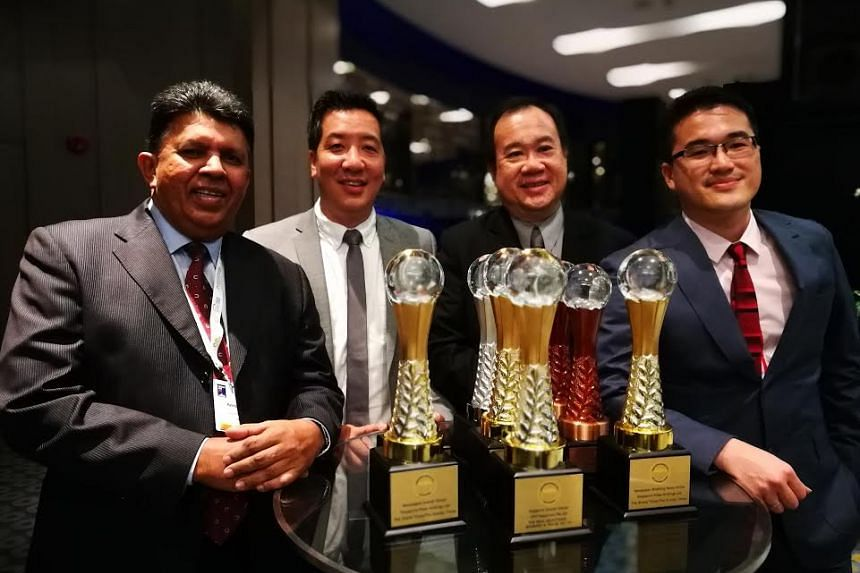 (From left) SPH's Deputy CEO Patrick Daniel, The Straits Times news editor Marc Lim, night editor Paul Cheong and Malaysia Bureau Chief Shannon Teoh with the awards won by The Straits Times.
