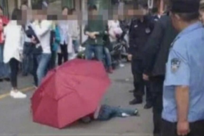 Chinese boy tried to use an umbrella as a parachute and jumps 10 storeys, but survives.