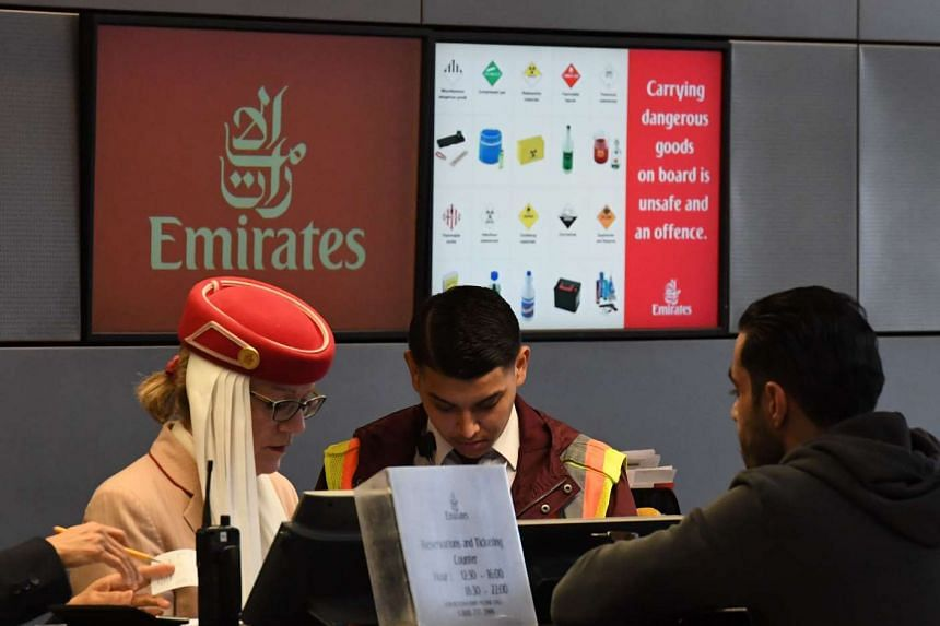 A passenger buys a ticket at an Emirates Airline counter in Los Angeles, California, on March 21, 2017.