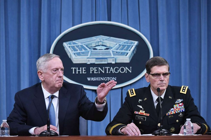 US Secretary of Defense James Mattis (left) and US Central Command Commander Joseph Votel taking part in a briefing at the Pentagon in Washington, DC, on April 11, 2017.