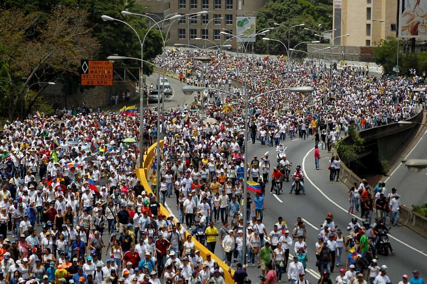 """Demonstrators rally during the so-called """"mother of all marches"""" against Venezuela's President Nicolas Maduro."""