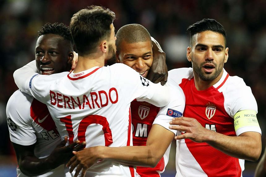 Monaco's Kylian Mbappe (second right) celebrates with his teammates after scoring the 1-0 lead.