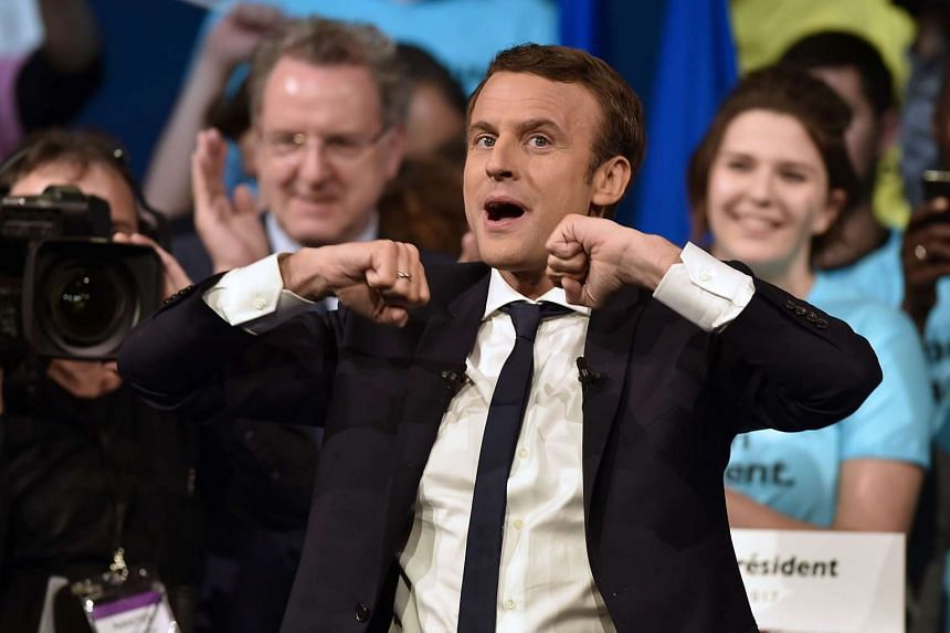 Centrist Emmanuel Macron clung on to his status as favourite to win France's presidential election in a four-way race that is too close to call.
