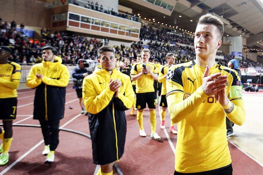 Dortmund's Marco Reus (right) and his teammates applaud fans after the match.