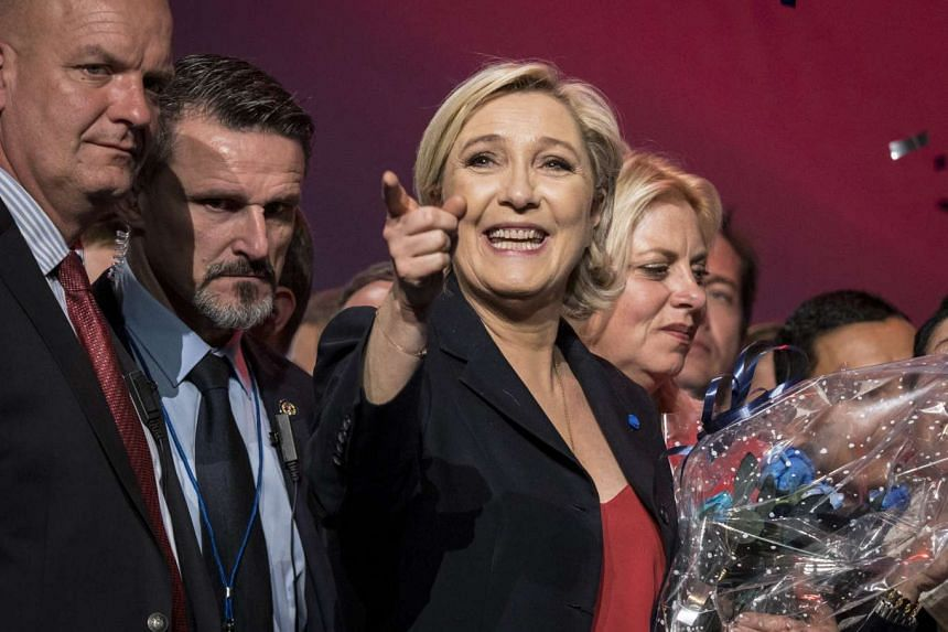Marine Le Pen (centre), French National Front (FN) political party leader and candidate for French 2017 presidential election, gesturing to supporters after her speech during an election campaign rally in Marseille, France, on April 19, 2017.