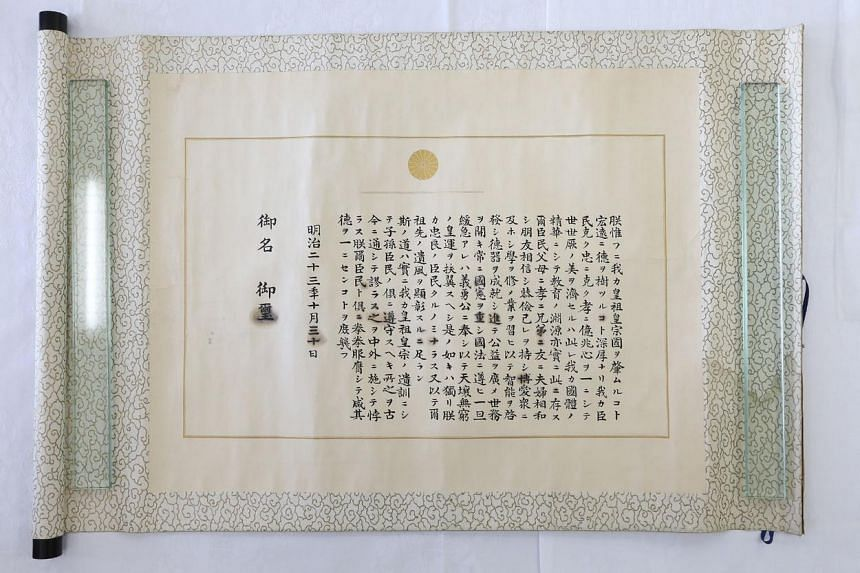 This photo taken on April 7, 2014 at Japan's Ministry of Education, Culture, Sports, Science and Technology in Tokyo shows a copy of the Imperial Rescript on Education promulgated in 1890.