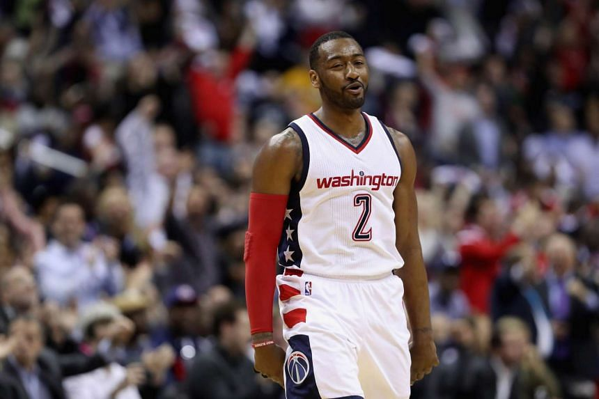 33118b24b444 John Wall  2 of the Washington Wizards reacting after making a shot during  the Wizards