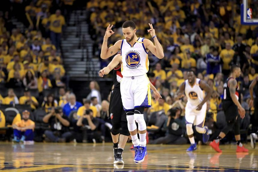 Stephen Curry of the Golden State Warriors celebrates after making a three-point basket in the match against the Portland Trail Blazers.