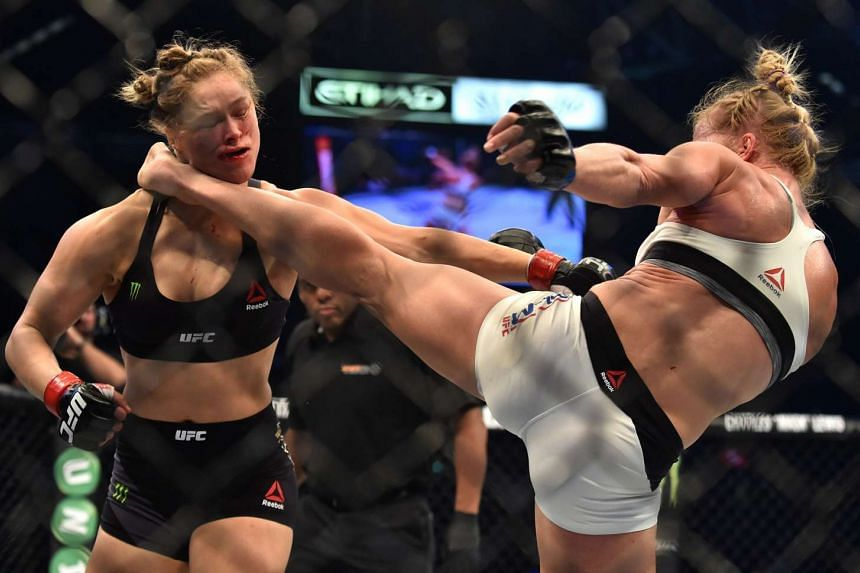 This file photo taken on Nov 16, 2015, shows Holly Holm landing a kick on compatriot Ronda Rousey.