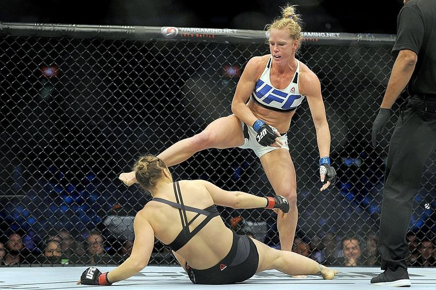 "Holly Holm (top) strikes defending champion Ronda Rousey in winning their women's bantamweight bout in Melbourne in November 2015. Her three subsequent losses have created the determination to ""constantly be improving"" as she prepares to face Bethe C"