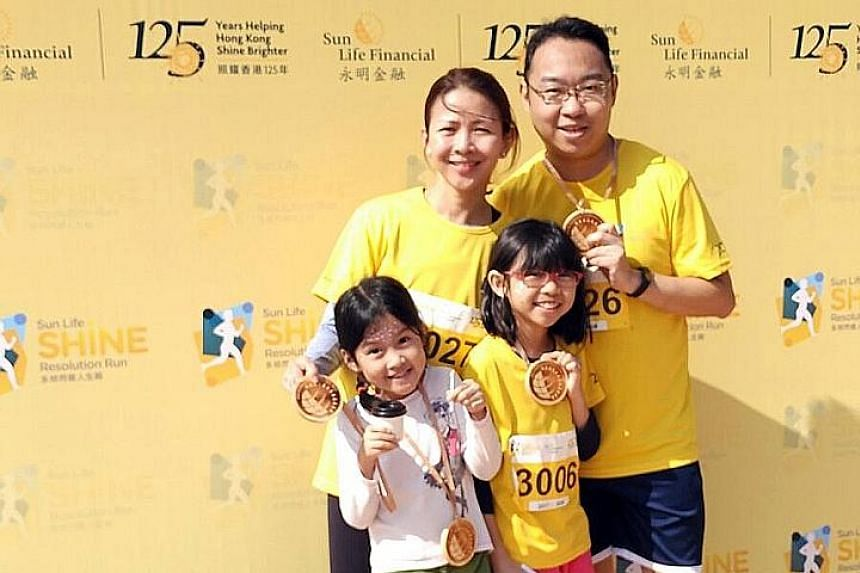 Shawn Khong, Wong Ching Ming, and their two daughters will be taking part in the ST Run, as part of their family activities.