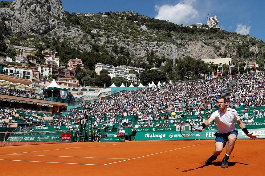 World No. 1 Andy Murray, who returned to the ATP Tour after an elbow injury, scrambling for a backhand during his 7-5, 7-5 win against Gilles Muller at the Monte Carlo Masters.