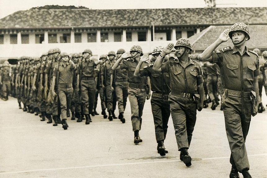 Mr Othman Wok, then a lieutenant in the People's Defence Force as well as the Minister for Social Affairs, leading the troops during a passing-out parade in 1969. Those who knew him said he was a man who, despite his stature, was respectful and humbl