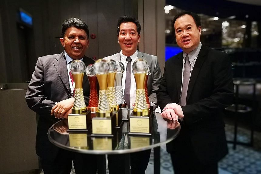 From left: SPH deputy chief executive officer Patrick Daniel, ST news editor Marc Lim and ST night editor Paul Cheong with the paper's haul of seven awards at the Asian Media Awards in Kuala Lumpur last night.