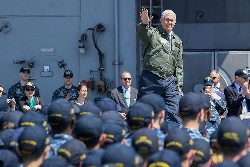 """US Vice-President Mike Pence on board the USS Ronald Reagan yesterday. He told 2,500 military personnel at the Yokosuka Naval Base that """"North Korea is the most dangerous and urgent threat to peace and security in the Asia-Pacific""""."""