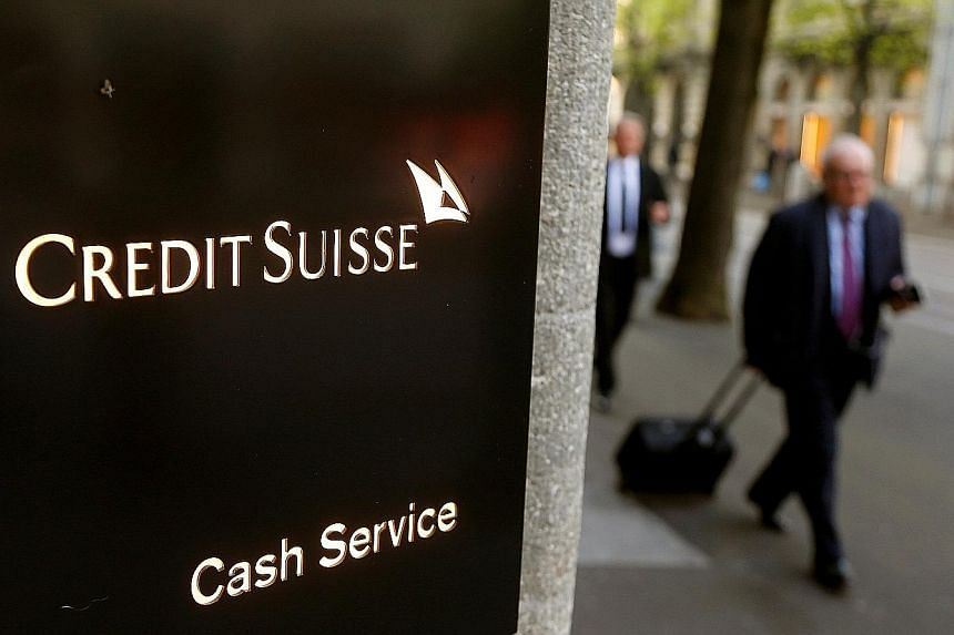 Credit Suisse on Friday sought to quell an outcry over compensation by proposing to lower bonuses for top executives and to freeze pay for the board of directors. Executives are offering to forgo 40 per cent of their bonuses.