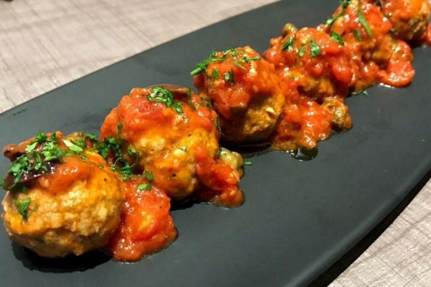 The Meatballs In Pizzaiola Sauce boasts tender pork and beef balls in a smooth tomato sauce. PHOTO: YEOH WEE TECK
