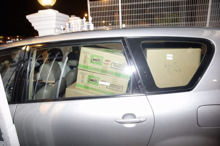 The car that left the Woodlands Wellington office was filled with boxes.