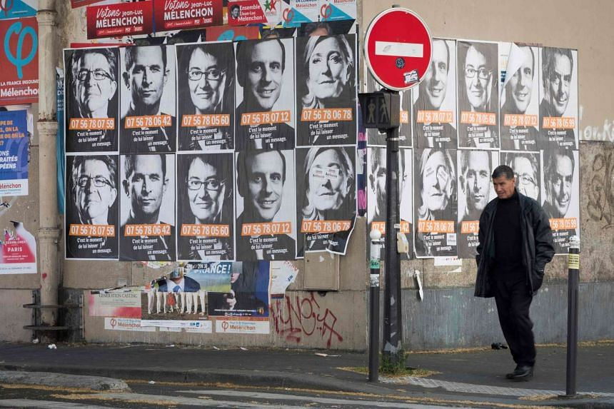Posters of the presidential election candidates in Paris.