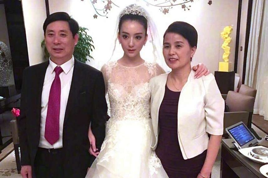 The bride (above) with her parents.