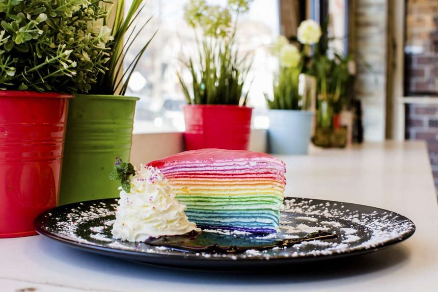 Rainbow crepe cake, with 20 layers and seams of whipped cream, at Dek Sen in New York. PHOTO: NYTIMES