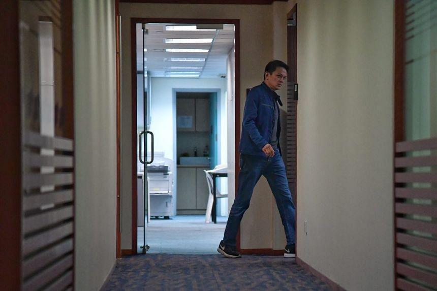 FAS general secretary Winston Lee walking into his office.