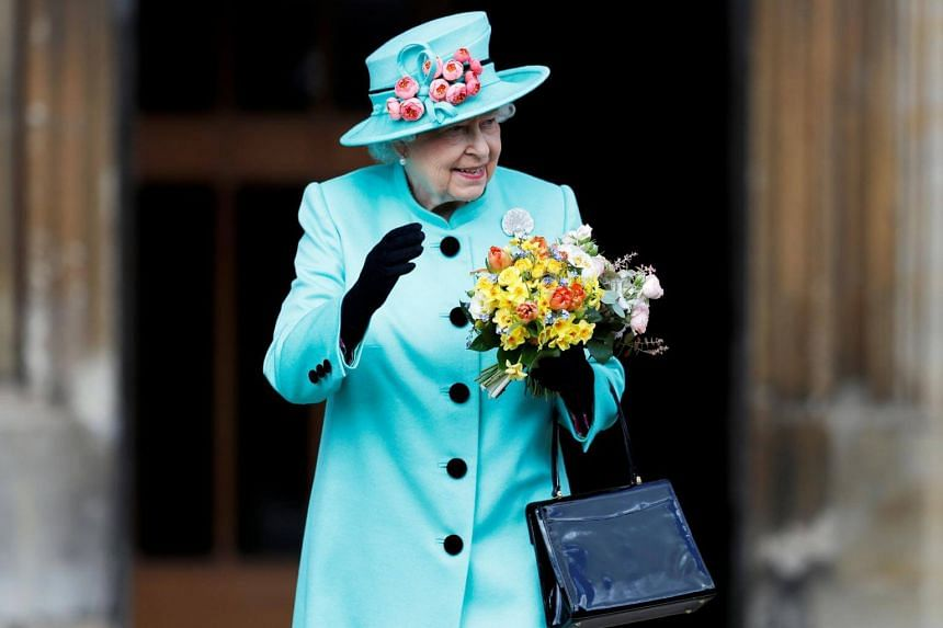 Britain's Queen Elizabeth II leaves the Easter Sunday service at St George's Chapel, Windsor Castle, on April 16, 2017.