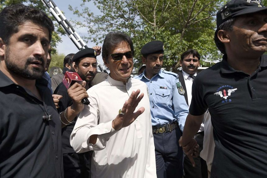 Opposition leader Imran Khan (centre) leaves the Supreme Court after its verdict over Panama leaks paper in Islamabad, Pakistan on April 20, 2017.