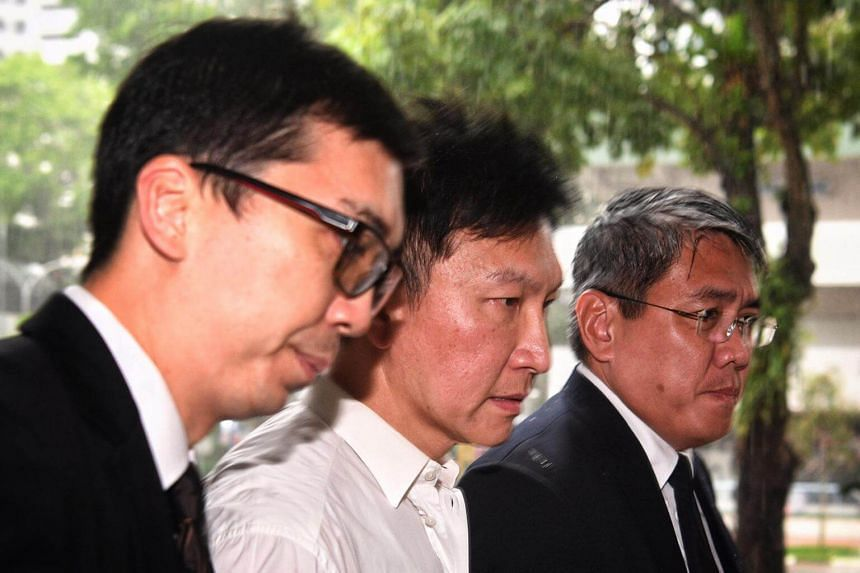 City Harvest Church founder and senior pastor Kong Hee walks towards The State Courts on April 21, 2017.
