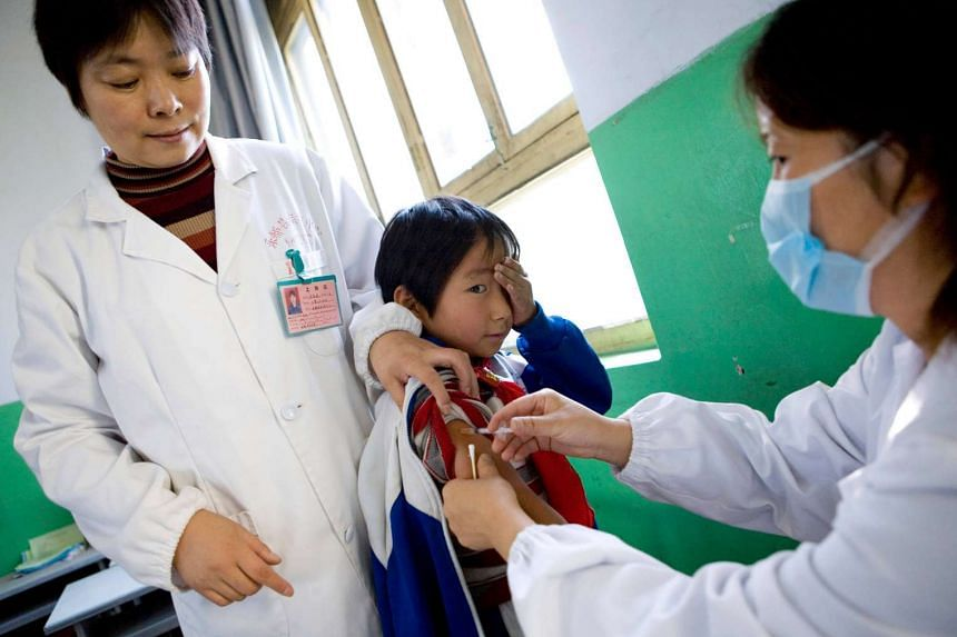 A young girl is among half a million children who are being vaccinated for Hepatitis B, as part of the Qinghai province vaccination programme, in a file photo from 2007.