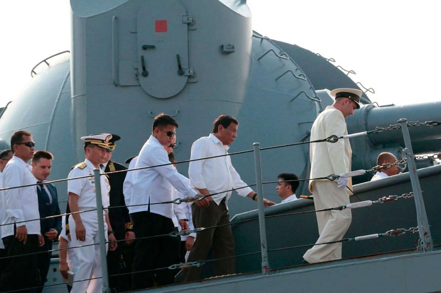 Philippines President Rodrigo Duterte (2nd right) is taken on a tour of the guided missile cruiser Varyag of the Russian Navy's Pacific fleet at South Harbor in Manila on April 21, 2017.