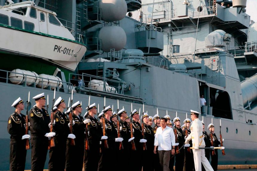 Philippines President Rodrigo Duterte is welcomed by a Russian Navy honour guard during his visit to the guided missile cruiser Varyag of the Russian Navy's Pacific fleet at South Harbor in Manila on April 21, 2017.