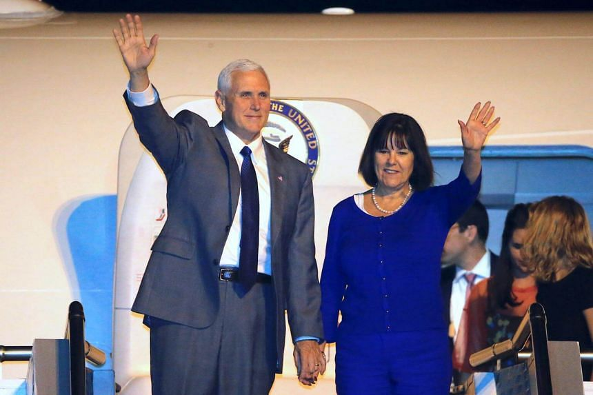 US Vice President Mike Pence waves with his wife Karen after arriving at Sydney International Airport in Australia, on April 21, 2017.