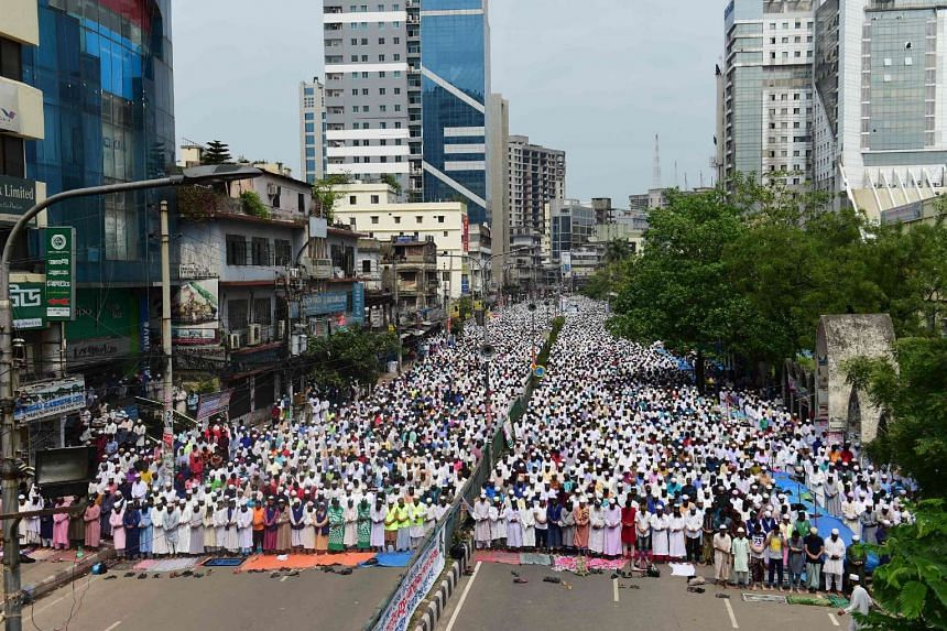Activists from an Islamist group offer Friday prayers prior to participating in a protest in Dhaka on April 21, 2017, which calls for the removal of a statue in front of The Supreme Court.