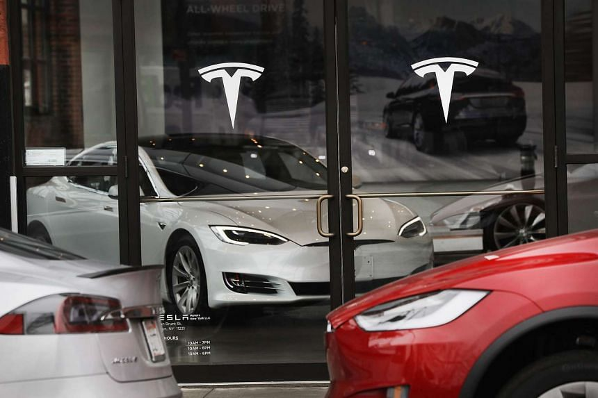 A Tesla car displayed in a showroom at a Brooklyn Tesla dealership in New York City.