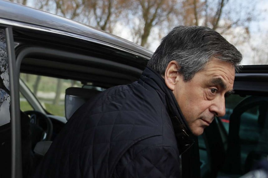 Francois Fillon makes a campaign visit to a former centre for migrants in northern France, April 18, 2017.