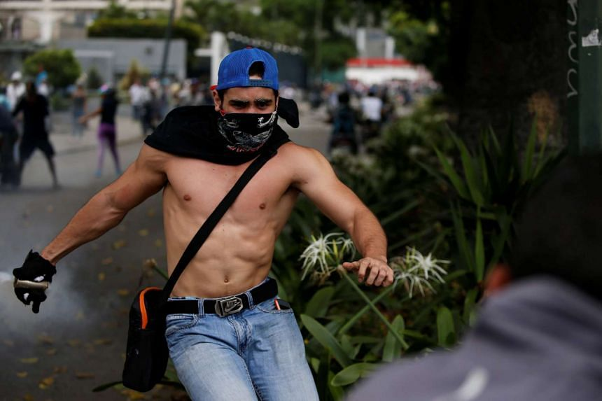 Demonstrators clash with riot police during a rally against Venezuela's President Nicolas Maduro in Caracas, Venezuela, April 20, 2017.
