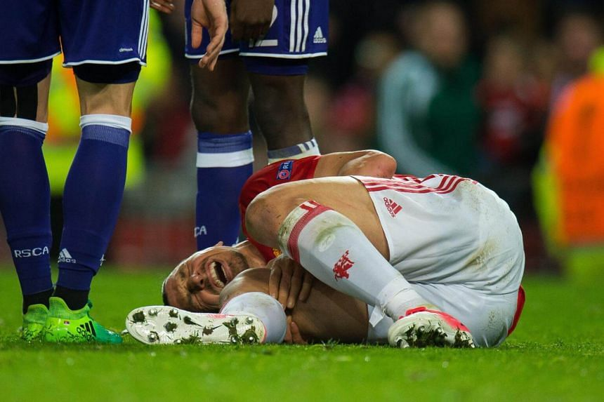 Manchester United's Zlatan Ibrahimovic reacts after picking up an injury during the Uefa Europa League quarter final, second leg soccer match between Manchester United and RSC Anderlecht at Old Trafford in Manchester, Britain, on April 20, 2017.