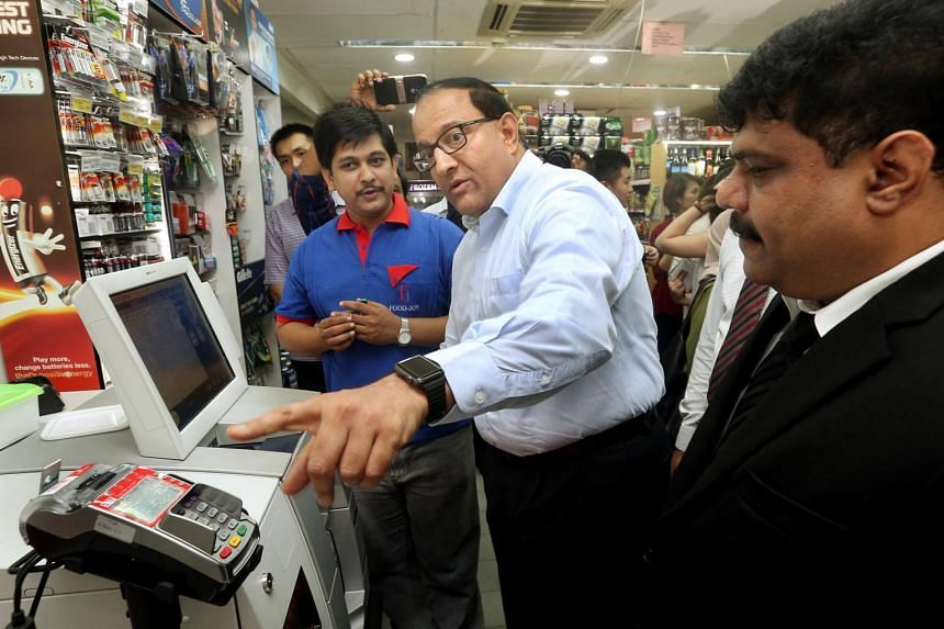 General manager S. Janakiraman shows Minister for Trade and Industry S. Iswaran how the self-checkout counter works at a learning journey on April 21, 2017.