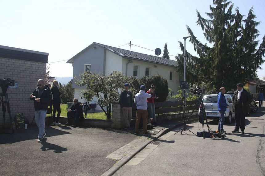 Media gather near the house of a man suspected of planting explosives targeting the bus of soccer team Borussia Dortmund.