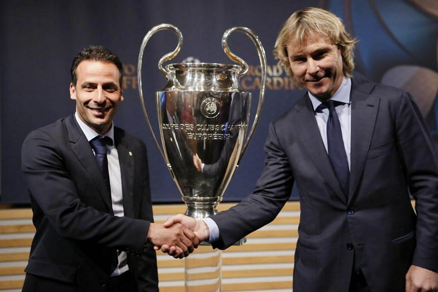 Former Monaco player Ludovic Giuly (left) and former Juventus player Pavel Nedved pose after the draw of the Uefa Champions League semi-finals.