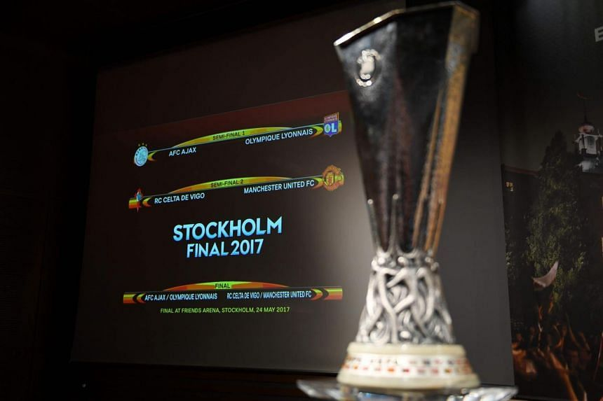 The result of the Uefa Europa league draw for the football competition's semi-finals is displayed on a screen next to the trophy, on April 21, 2017 in Nyon.