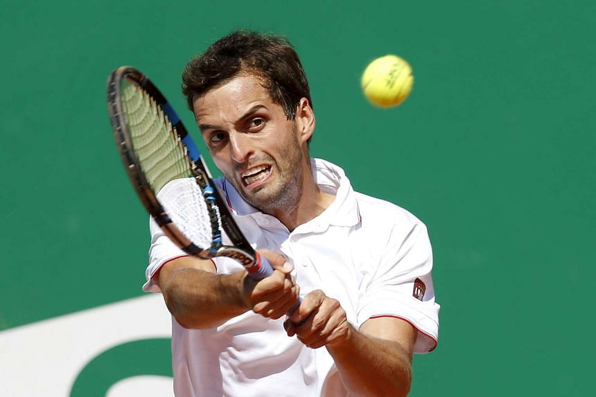 Albert Ramos-Vinolas of Spain returns the ball to Marin Cilic of Croatia during their quarter final match.