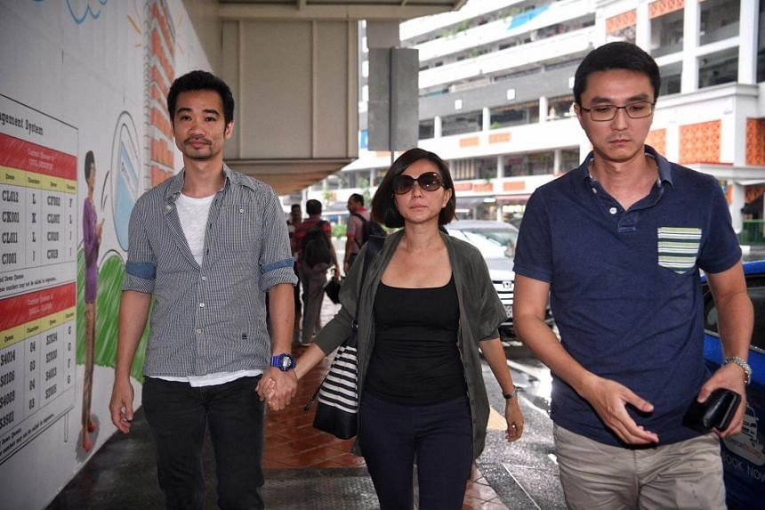 Former City Harvest Church finance manager Serina Wee, accompanied by her husband (left), walks towards The State Courts on April 21, 2017.