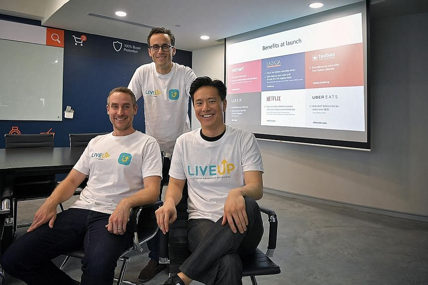 (From left) RedMart chief executive and co-founder Roger Egan, Lazada Singapore chief executive Alexis Lanternier and general manager of Uber Singapore Warren Tseng at the launch of membership programme LiveUp at the Lazada office yesterday.