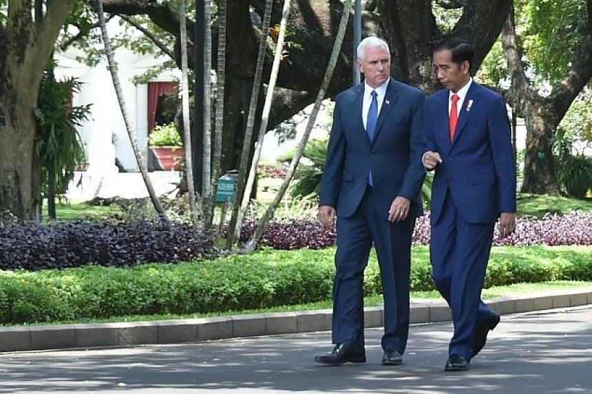 Mr Mike Pence and Mr Joko Widodo at the Merdeka Palace yesterday. Mr Pence also visited a mosque in Jakarta.